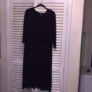 Black dress. Faux wrap top. 3/4 sleeves Kneelength